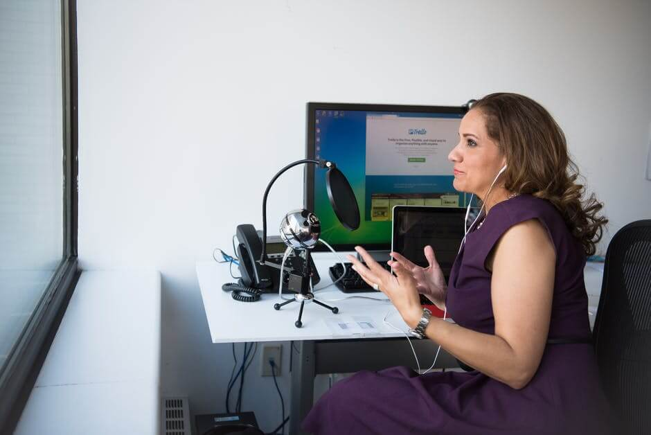 A woman standing in front of a computer
