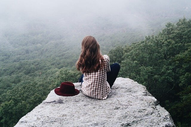 A person sitting on a rock